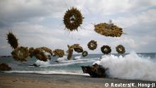 Amphibious assault vehicles of the South Korean Marine Corps fire smoke bombs as they move to land on the shore during a U.S.-South Korea joint landing operation drill as a part of the two countries' annual military training called Foal Eagle, in Pohang, South Korea, April 2, 2017. REUTERS/Kim Hong-Ji