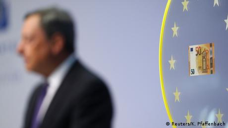 ECB chief Mario Draghi next to a €50 bill