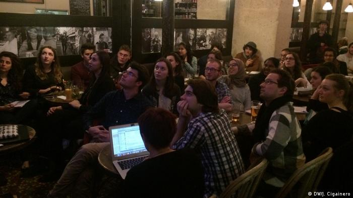 French voters watch the presidential debate in Cafe des Phares in Paris