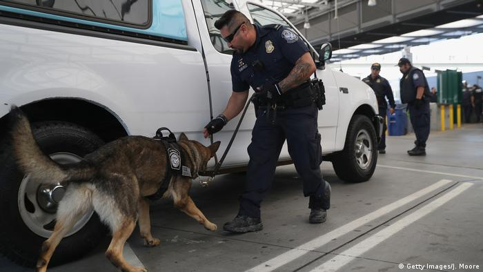 A U.S. Customs and Border Protection K-9 unit checks vehicles crossing into the United States from Mexico