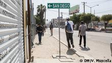 A street sign in Tijuana, Mexico, indicates the direction of San Diego, California, in the United States