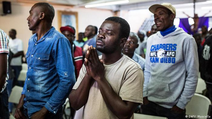 Haitian migrants pray during a mass at the Desayunador Salesiano shelter in Tijuana, Mexico