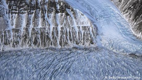 Ice is beginning to melt on a glacier along the Upper Baffin Bay coast above Greenland.