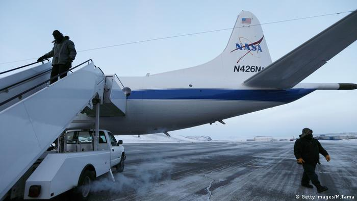 Crew members prepare the retrofitted 1966 Lockheed P-3 aircraft for takeoff from Thule Air Base on March 27, 2017 in Pituffik, Greenland.