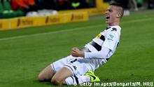 MOENCHENGLADBACH, GERMANY - APRIL 05: Laszlo Benes #22 of Gladbach celebrates after he scores the opening goal during the Bundesliga match between Borussia Moenchengladbach and Hertha BSC at Borussia-Park on April 5, 2017 in Moenchengladbach, Germany. (Photo by Maja Hitij/Bongarts/Getty Images)