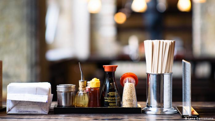 Soy sauce and other spices on a table at Japanese restaurant Cocolo Ramen in Berlin (Photo: Lena Ganssmann)