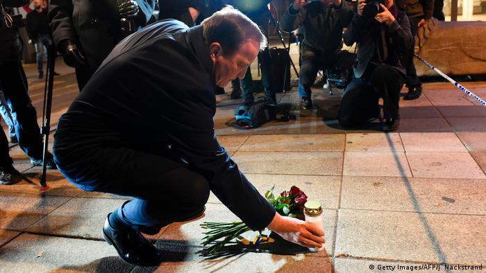 Swedish Prime Minister Stefan Lofven lays flowers and a candle at the attack scene (Getty Images/AFP/J. Nackstrand)
