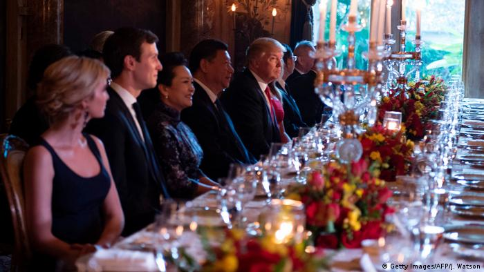 US President Donald Trump and Chinese President Xi Jinping look on during dinner at the Mar-a-Lago estate in West Palm Beach, Florida