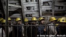 ZONGULDAK, TURKEY - APRIL 04: Coal miners wait to take the elevator back to the surface after finishing their shift at a large government run coal mine on April 4, 2017 in Zonguldak, Turkey. More than 300 kilometers of coal mineÕs riddle the mountains of Zonguldak. The coal-mining city in the Black sea region of Turkey was established in 1849 as a port city and mining hub. However the province with a population of more than 500,000 is facing an uncertain future. As the coal mining industry globally sees a steady decline, Zonguldak and surrounding towns are also at a cross roads with coal miner numbers dwindling from some 60,000 in peak years to now just over 6000 working in the city. Steady population decline, Turkeys current economic crisis, cheap coal imports from Columbia and Russia, as well as a series of mining disasters, such as the 2014, Soma mine fire, which forced parliament to adopt a new code to improve safety conditions, which raised some mine operating costs by 50 percent, have all contributed to a decline in profit and have pushed many mining companies into financial difficulty. However with TurkeyÕs Minster of Energy and Natural resources pushing new policies focusing on domestic resources and reducing TurkeyÕs energy import dependence, many companies and miners hope that they will see a revitalized industry in coming years. (Photo by Chris McGrath/Getty Images)