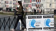 A woman walks near a placard reading Peace workers in Bayonne, southwestern France, Friday, April 7, 2017. The armed Basque separatist group ETA, inactive for more than five years, is to hand over its arms Saturday, a finishing touch to a 43-year violent campaign that claimed 829 lives, mostly in Spain. (AP Photo/Bob Edme) |