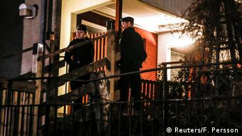 Police officers are seen in Stockholm after a raid following a suspected terror attack on the Drottninggatan Street