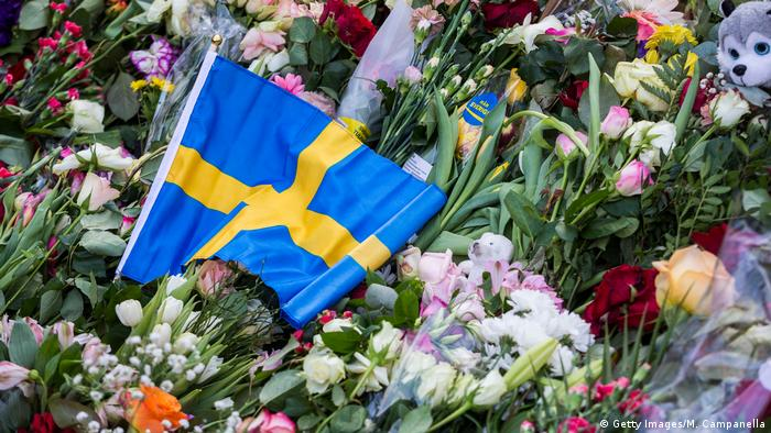 Flowers left at memorial for victims of Stockholm terrorist attack