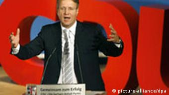 The general secretary of Merkel's CDU party, Roland Pofalla speaking at a party conference