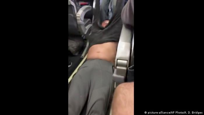 United Airlines settles with passenger who was dragged from plane