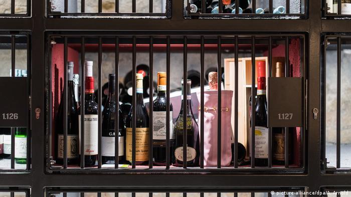 wine bottles behind bars
