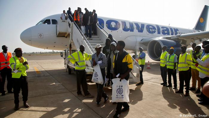 Gambian migrants voluntarily return to the airport in Banjul (Reuters/L. Gnago)