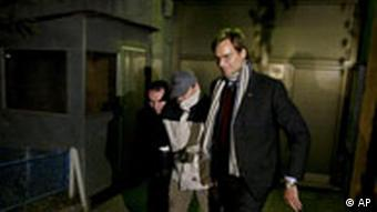 One of the three German agents leaves the Pristina Detention center