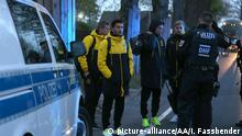 DORTMUND, GERMANY - APRIL 11 : Sven Bender, Nuri Sahin and Marcel Schmelzer (C) of Borussia Dortmund stand at their bus at the hotel L'Arrivee on April 11, 2017. The UEFA Champions League quarter-final soccer match between Borussia Dortmund and AS Monaco has been postponed after an explosions near the bus carrying the Dortmund team, injuring one player. INA FASSBENDER / Anadolu Agency | Keine Weitergabe an Wiederverkäufer.