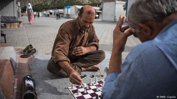 Syrian men play chess in Nizip, Turkey