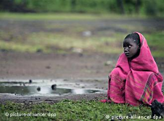 A child sits and waits for clean water in Zimbabwe