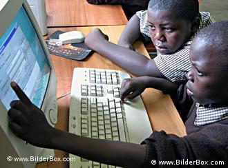 Two boys work at a computer