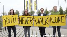 12.04.2017 Dortmund supporters hold posters You'll never walk alone outside the training ground of Borussia Dortmund in Dortmund, Germany, Wednesday, April 12, 2017, one day after an explosion at the bus of the team prior to the Champions League quarterfinal soccer match between Borussia Dortmund and AS Monaco (AP Photo/Mike Corder)  