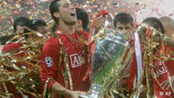 Manchester United's Cristiano Ronaldo celebrates with the trophy at the end of the Champions League final