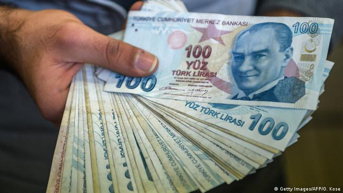 Turks have seen the steady decline in value of the Turkish lira against the dollar (Getty Images/AFP/O. Kose)