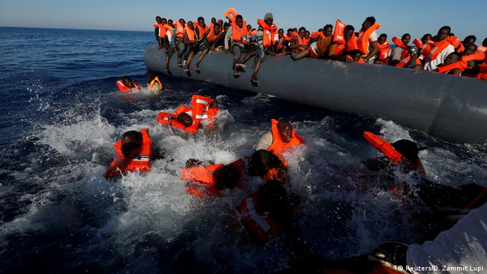 Migrants try to stay afloat in Mediterranean