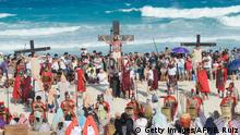 Actors perform the Passion of Jesus Christ during the Good Friday's procession at the Cancun resort, Quintana Roo State, Mexico, on April 14, 2017. The Living Passion is a representation of the Passion of Christ from the last supper to his crucifixion, death and resurrection. / AFP PHOTO / ELIZABETH RUIZ (Photo credit should read ELIZABETH RUIZ/AFP/Getty Images)