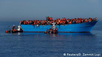 Migrants off the coast of Libya being rescued by MOAS crew