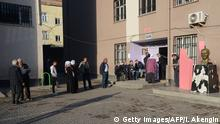 People gather to cast their vote in Turkey's tightly-contested referendum on expanding the powers of President Recep Tayyip Erdogan, April 16, 2017 in the center of Diyarbakir, seen as a crossroads in the modern history of the country. The referendum is taking place under a state of emergency that has been in place since last summer's failed coup which has seen some 47,000 arrested in the biggest crackdown in Turkey's history. The first polling sta / AFP PHOTO / ILYAS AKENGIN (Photo credit should read ILYAS AKENGIN/AFP/Getty Images)