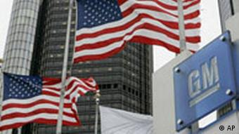 GM headquarters in Detroit with two US flags
