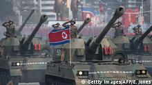 15.11.2017*** TOPSHOT - Korean People's Army (KPA) tanks are displayed during a military parade marking the 105th anniversary of the birth of late North Korean leader Kim Il-Sung in Pyongyang on April 15, 2017. North Korean leader Kim Jong-Un on April 15 saluted as ranks of goose-stepping soldiers followed by tanks and other military hardware paraded in Pyongyang for a show of strength with tensions mounting over his nuclear ambitions. / AFP PHOTO / Ed JONES (Photo credit should read ED JONES/AFP/Getty Images)