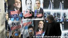 Election posters showing candidates for the 2017 presidential election Emmanuel Macron, Benoit Hamon, Francois Fillon, Jean-Luc Melenchon and Marine Le Pen are seen in Paris, France on April 9, 2017. Photo by Alain Apaydin/ABACAPRESS.COM  
