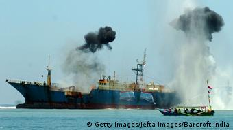 An illegal fishing vessel being sunk near West Java