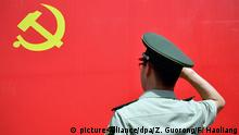 A Chinese paramilitary policeman, also a member of the Communist Party of China, swears in to celebrate the 95th anniversary of the founding of the CPC in Hangzhou city, east China's Zhejiang province, 30 June 2016. The Communist Party of China's membership in 2015 grew at its slowest pace since 1989, its Organization Department said on Thursday (30 June 2016) in an annual bulletin ahead of the 95th anniversary of the party's founding which falls on Friday (1 July 2016).