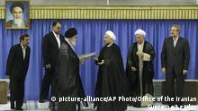 03.08.2013 In this picture released by the official website of the Iranian supreme leader's office, Supreme Leader Ayatollah Ali Khamenei, center with black turban, gives his official seal of approval to President-elect Hasan Rouhani, in an official endorsement ceremony, in Tehran, Iran, Saturday, Aug. 3, 2013. Iran's supreme leader has formally endorsed Hasan Rouhani as president opening the way for the moderate cleric to take over from outgoing President Mahmoud Ahmadinejad. Parliament speaker Ali Larijani, right, head of the Expediency Council Akbar Hashemi Rafsanjani, second right, judiciary chief Sadeq Larijani, left, secretary of Guardian Council Ahmad Jannati, second left, and outgoing President Mahmoud Ahmadinejad, third left, attend the ceremony. An unidentified official of the supreme leader's office stands at rear center. A portrait of the late revolutionary founder Ayatollah Khomeini hangs in background. (AP Photo/Office of the Iranian Supreme Leader)  