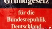 Symbolbild deutsche Sprache im Grundgesetz. Fotomontage