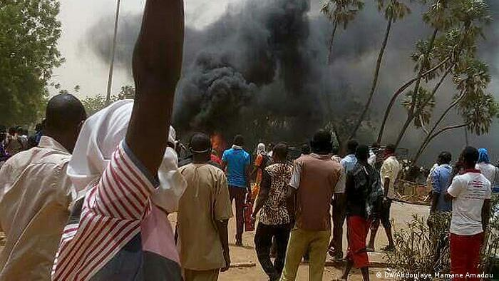 Students in Niger's capital Niamey set car tires on fire during a protest calling for educational reform