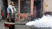 22 September 2016*** epa05551599 An Indian Municipal Corporation sanitation worker fumigates a residential area as part of an n anti-dengue fumigation drive to curb breeding sites for mosquitoes causing a dengue outbreak in New Delhi, India, 22 September 2016. According to a news report, dengue-chikungunya has spread widely in Delhi with hundreds of people suffering from the mosquito-borne tropical disease. EPA/STR  