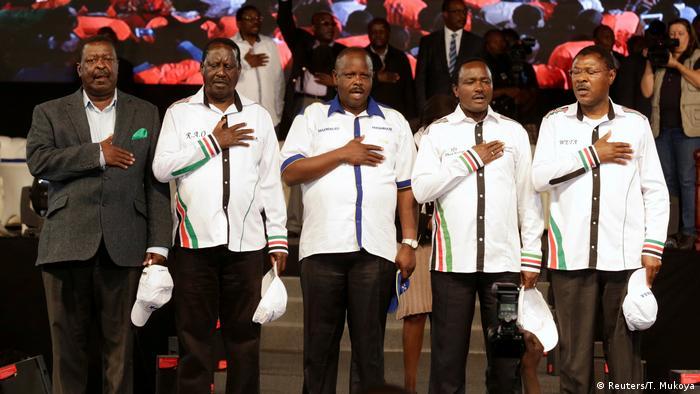 Kenyan opposition leaders Musalia Mudavadi, Raila Odinga, Isaac Ruto, Kalonzo Musyoka,and Moses Wetangula standing together and singing the national anthemi