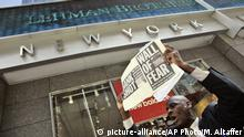 A man demonstrates outside the Lehman Brothers headquarters Monday, Sept. 15, 2008 in New York. Lehman Brothers, a 158-year-old investment bank choked by the credit crisis and falling real estate values, filed for Chapter 11 protection in the biggest bankruptcy filing ever on Monday and said it was trying to sell off key business units. (AP Photo/Mary Altaffer) |