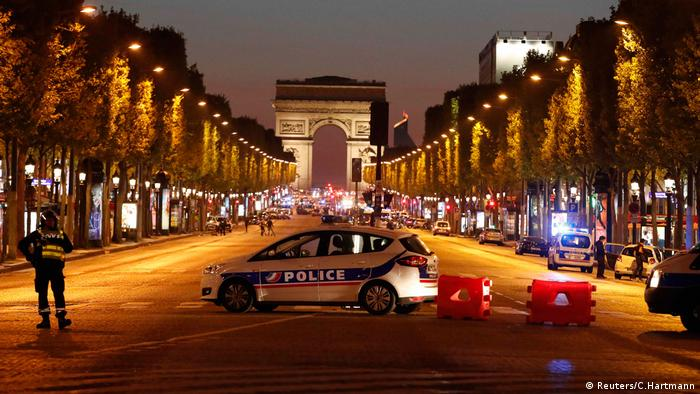 Police secure the world-famous Champs-Elysees boulevard