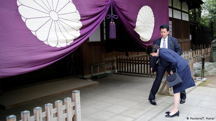 Japan's internal affairs and communications minister Sanae Takaichi bows as she visits the Yasukuni shrine (Reuters/T. Hanai)