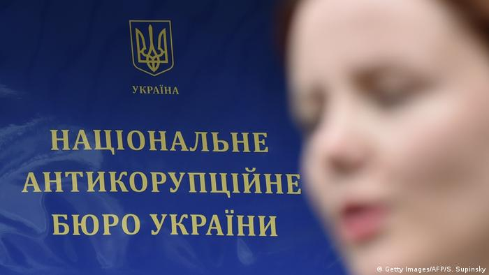The press secretary of the National Anti-Corruption Bureau of Ukraine (NABU) speaks during an interview with AFP in front of the bureau's offices in Kyiv