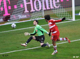 Munich's Luca Toni tries to score against Hoffenheim's goalkeeper Daniel Haas