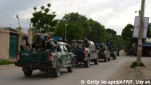 21.04.2017 *** Afghan security personnel arrive at the site of an ongoing attack on an army compound in Dihdadi District of Balkh province on April 21, 2017. At least eight Afghan soldiers have been killed and 11 wounded during an ongoing Taliban attack on their base in northern Afghanistan, the defence ministry said.Gunmen wearing Afghan army uniforms have launched a complex attack on an army compound in the outskirts of Mazar-e-Sharif,capital of Balkh province, ministry spokesman Dawlat Waziri told AFP. / AFP PHOTO / FARSHAD USYAN (Photo credit should read FARSHAD USYAN/AFP/Getty Images)