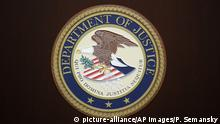 The U.S. Department of Justice logo is seen on a podium following a news conference in the office of the U.S. Attorney for the District of Maryland in Baltimore, Wednesday, March 1, 2017. (AP Photo/Patrick Semansky) |