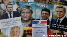 A photo illustration shows a French voter card in front of pictures of the candidates for the French presidential election, April 22, 2017. REUTERS/Pascal Rossignol/Illustration